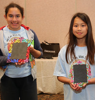 camp kids showing their arts and crats creations