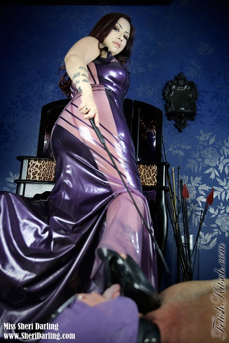 Latex clad Mistress