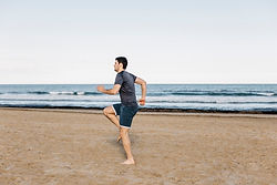 man-running-spot-beach_23-2147802925.jpg