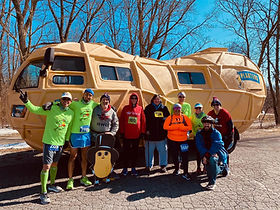 Key Sports running pace team and volunteers with the Planters peanut mobile