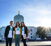 Three student standing at the Oregn capitol
