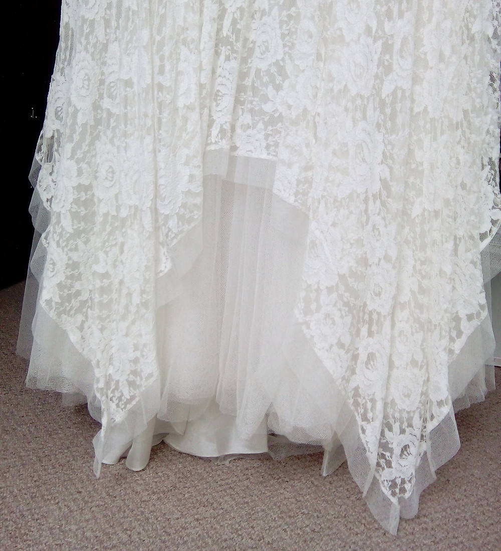 Wedding dress hem shortening alterations bridal gown seamstress