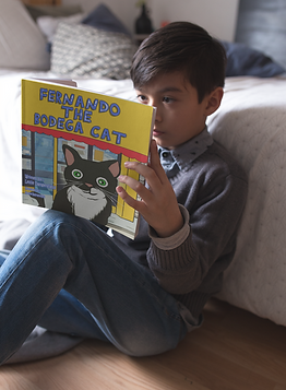 boy-reading-a-square-book-mockup-sitting