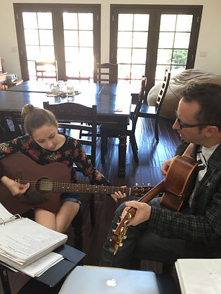 Ron offers private and group instruction in guitar, piano, bass, theory, songwriting & more