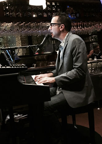 Ron DePuy performs solo on piano and guitar as well as with several bands based out of San Diego