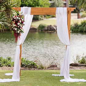 bamboo arbour arch flowers wedding ntwin waters chffon ceremony pandanus lawn novotel events styling timber boho burgundy