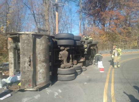 Garbage Truck Rollover Closes Gately Overpass
