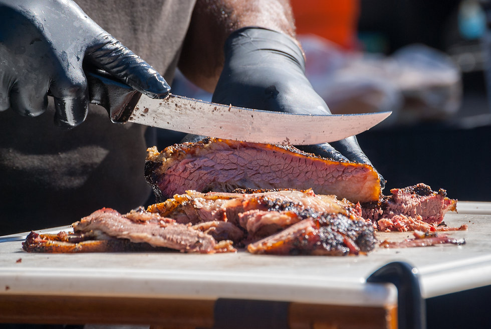 Hands slicing beef fresh out of the smok