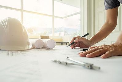 hands-of-engineer-working-on-blueprint-c