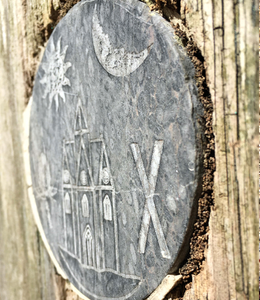 Slate medalion depicting the Ashburton Town Crest