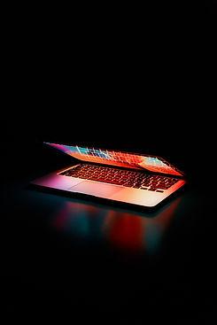 semi-opened-laptop-computer-turned-on-on