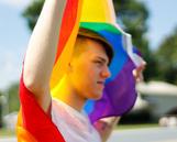 Man holding Pride Flag