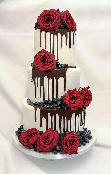 Chocolate drip wedding cake with roses