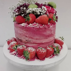 Naked cake with fresh flowers & strawberries