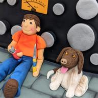 Detail of radio cake with man & his dog