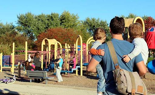 dad-holding-kids-playground.jpg