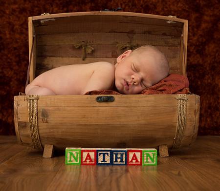 newborn baby in a barrel