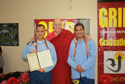 with students at a graduation at Avenal State Prison
