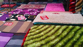 Floor display of rugs
