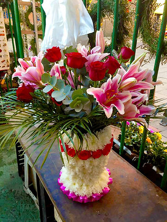 Bouquet with flower decorated vase