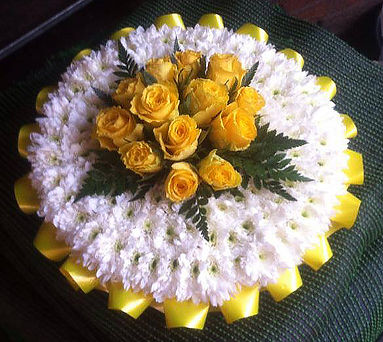 Yellow and white round wreath with ribbons