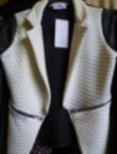 White quilted sleeveless jacket