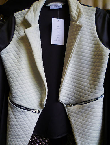 White quilted sleeveless jacket