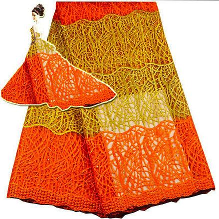 Orange lace skirt with dressed illustrative doll