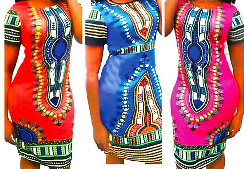 Three elaborately patterned African dresses