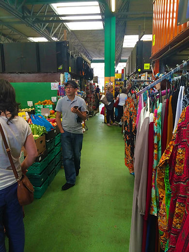 Internal view of Market looking along aisle with customers