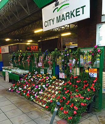 Outside stall display of varied flowers and greenery