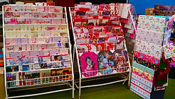 Staggered greetings cards racks