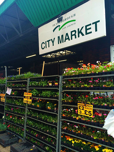 City Market Sign with Flowers Display