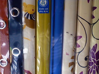 Various coloured eyeleted blinds
