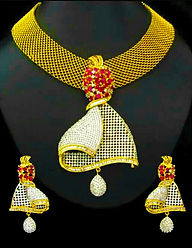 Ornate gold coloured necklace and earrings