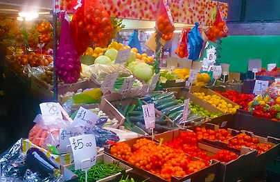 Stall side view with various fruits and vegetables
