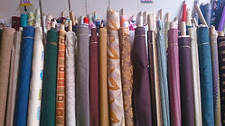 Vertical display of fabric rolls