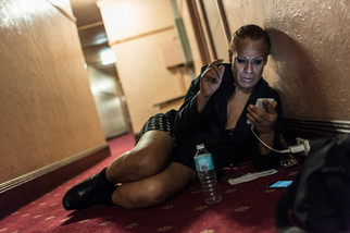 Charleze, 50, 2 years at the Gatwick, is waiting in the hallway to charge her phone. She no longer has a room. May 2017.