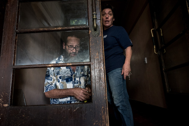 """Allan, who lives and works at the Gatwick as a janitor, repairs for the ninth time a window of the front door. Allan arrived at the Gatwick 27 years ago. """"Devastated"""" by its closing, he finds the place """"Extraordinary: Rose and Yvette are doing their best."""" Yvette, 60, the Gatwick co-owner, is asking residents and non-residents to make less noise on the street. February 2017."""