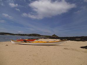 Kayaks on beach Scilly Isles
