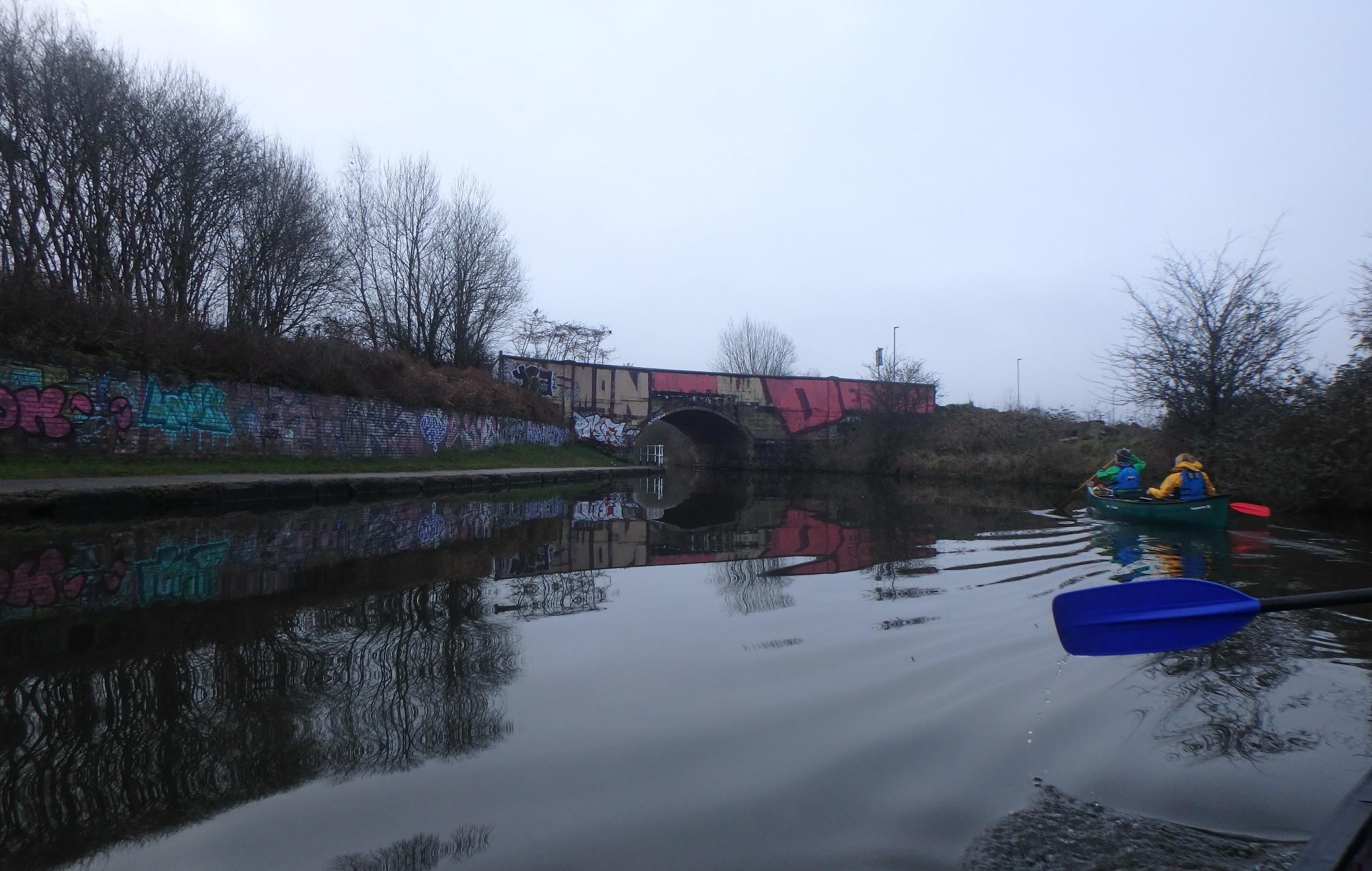 Canoeing reflection and graffitti
