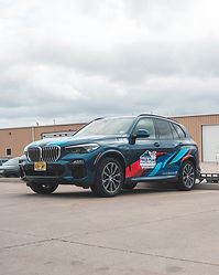 Custom printed decals for pikes peak internatinal hill climb on a BMW X7
