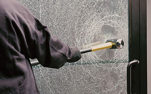 Xpel Security Clear window tint on glass door being hit with a sledgehammer