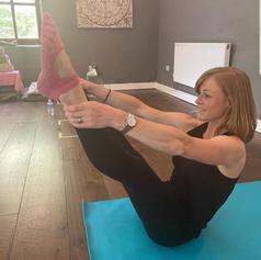 Yoga studio teacher in practice