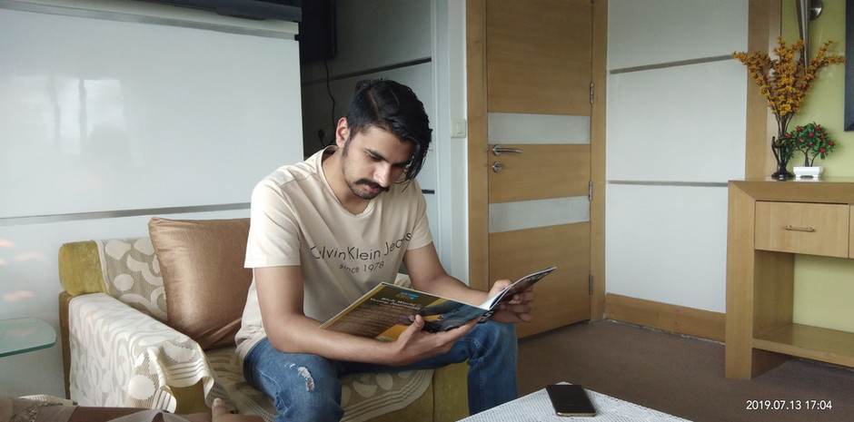 Mr. Mantraj Paliwal, Vice-Chairman, Miraj Group scrolling through Blub World Magazine