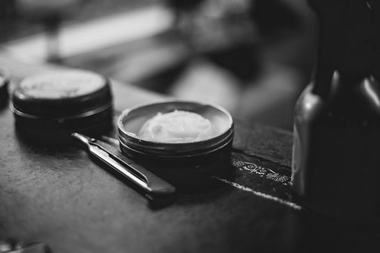 Pomade and a razor.  Just a few tools used in the barbershop business.