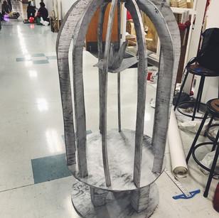 Wood puzzle piece sculpture- bird in a bird cage