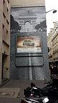 Mur d'affichage habillé en trompe l'œil
