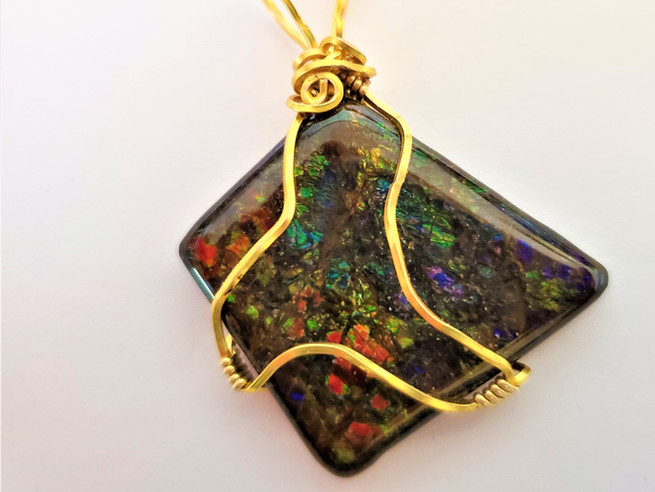 ROXEEs Wire Wrapped Very Colorful Canadian Ammolite.jpg
