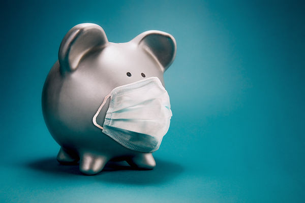 Close up of piggy bank, wearing protecti